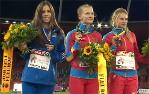 Katerina Stefanidi stands on the podium with a Silver Medal at the 2014 European Championships.